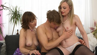 Two mature housewives share their toyboy's cock