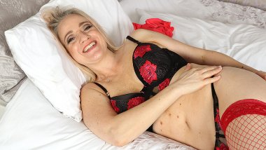 Naughty mom playing with herself in bed