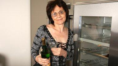 Horny mature slut loves masturbating while drinking champagne