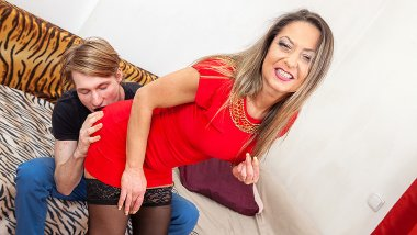 Shaved MILF getting it on with a toyboy