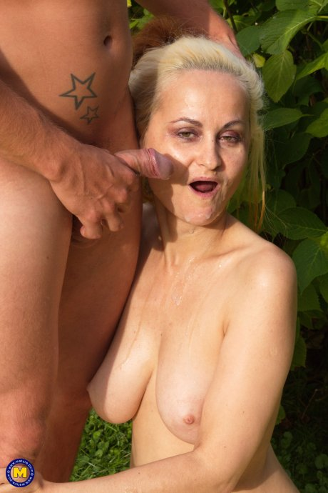 This cougar gets fucked in the open air by a toyboy