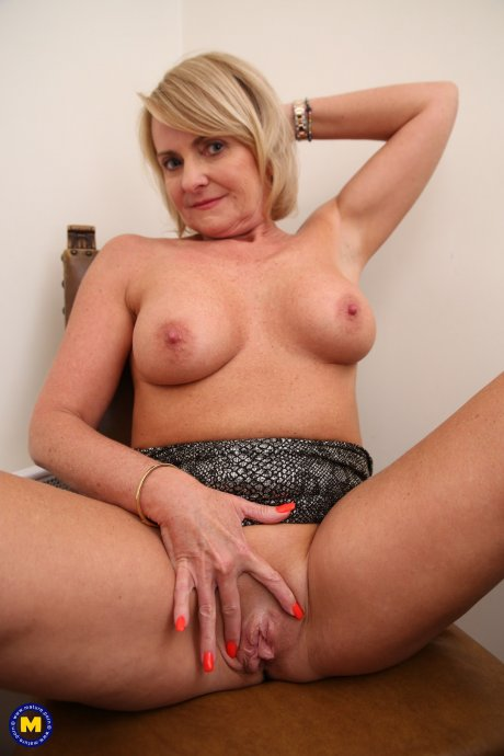 Naughty MILF getting wet behind her laptop at the office