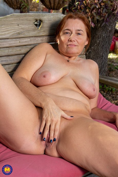 Naughty mature lady getting naked in the open air