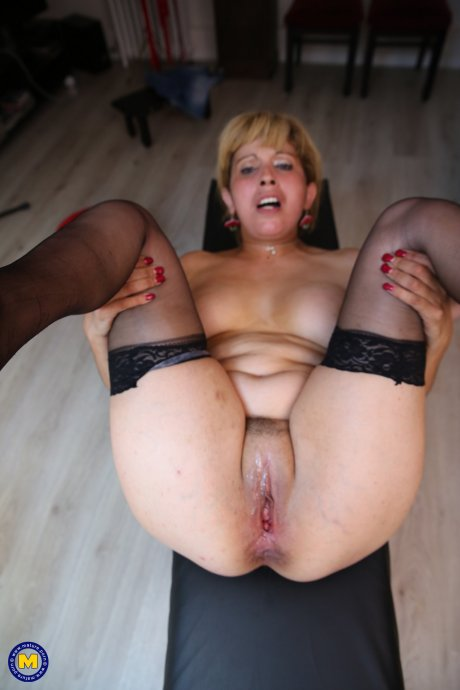 This naughty cougar loves to do two guys at once in a van