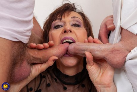 Mature slut taking on two younger cocks at once