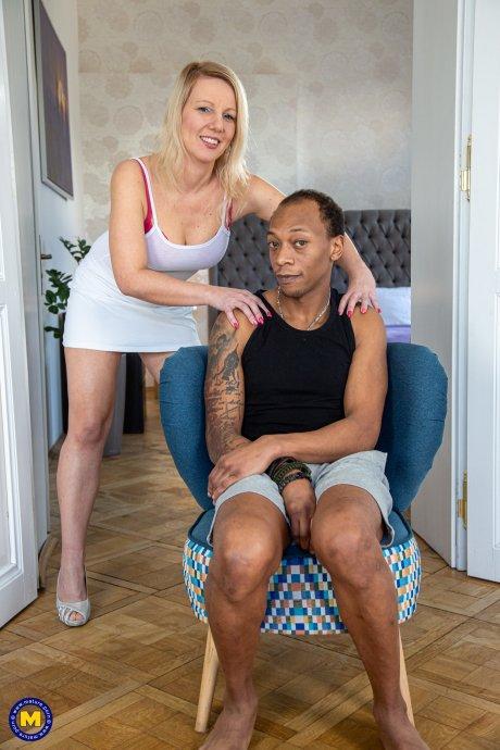 Horny Blonde MILF munching on a big hard black cock