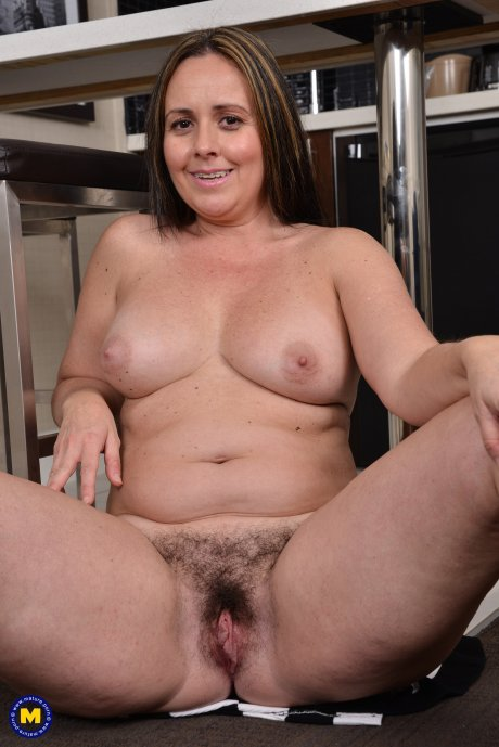 Hairy mom playing with herself in the kitchen