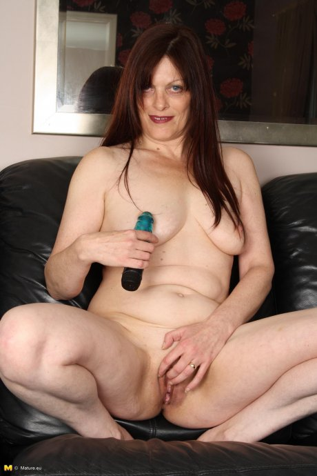 Horny brunette housewife playing alone
